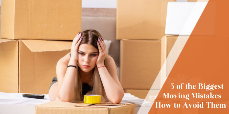 worried woman leaning on packing boxes