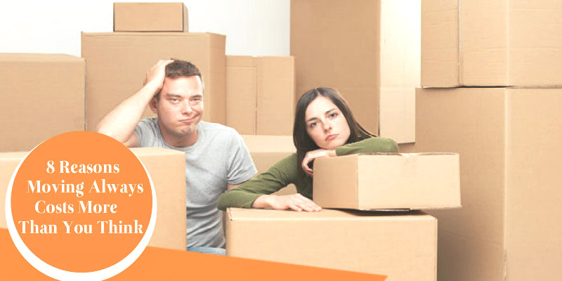 worried couple sitting with packed boxes
