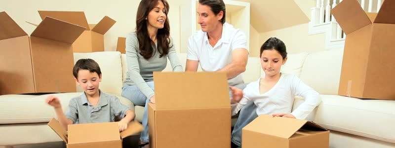 A family is packing household for a house move