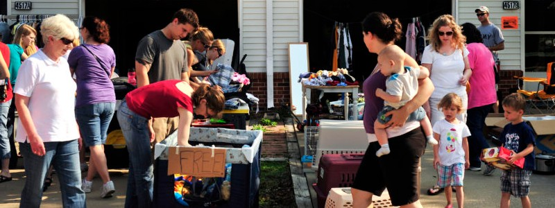 People are shopping in a garage sale