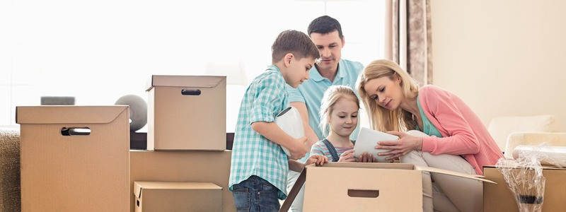 entire family unpacking their household after relocation
